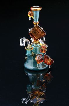 A glass water pipe by Chaka has ice cubes that look like they are melting off the glass.