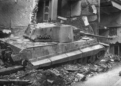Supporting the rear of the column were heavy tanks of Schwere SS-Panzer-Abteilung 501. Amongst them SS-Obersturmführer Jürgen Wessel sought to negotiate the narrow streets of the town which was still being defended by small units of American soldiers.