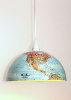 """DIY Globe Pendant - Maps and globes are all the rage in decor right now, so we are loving this easy, """"form meets function"""" project! Transparent Plastic Sheet, Map Wrapping Paper, Map Coasters, Globe Crafts, Bee Creative, Mosaic Flower Pots, Globe Pendant Light, Globe Ornament, Drop Cloth Curtains"""