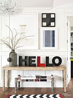 """Greet your guests with expressive exhibits -- such as this lively mix of vintage gear and vivid hues -- that host inviting artworks or displays that simply say, """"Hello.""""/"""