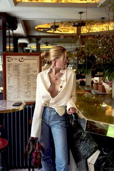 Top blogger Camille Charrière is giving us an irresistibly cool inspiration on how to give our go-to button-down shirts a sexy twist. It takes a bit of confidence, but all you have to do is keep it unbuttoned past the chest, tuck it just so into a pair of high-waisted jeans, and let the sleeves hang down and open for the final touch.