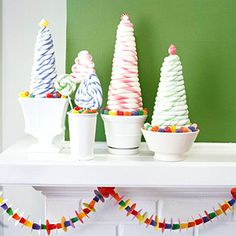 Potted Candy Trees and Flowers Hard fondant looks as soft and fluffy as marshmallows in this picturesque tree-and-sucker arrangement. Lined with gumdrops, the sweet pots are a confectioner's dream of a holiday floral arrangement.