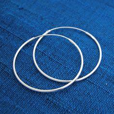 silver hoop earrings.