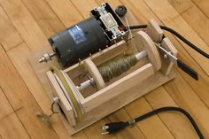 Build your own electric spinning wheel. Although I don't want electric it could help with the mechanics of build one.