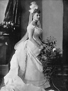 Mary of Teck - in her Court Presentation dress. And almost coming out of it.