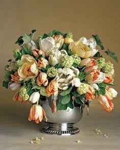 tulips, greens, Snowball Viburnum ... would look nice in ceramic vase