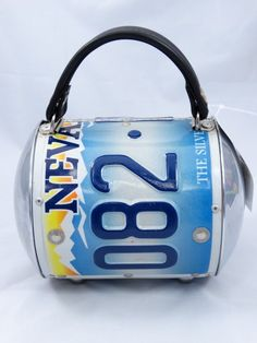 Just in! Little Earth License Plate Super Cyclone Purse. Save up to 70% off retail at www.ShopKarma.com. High end pre owned designer bags, clothing, shoes and accessories. #karmacouture #shopkarma #upscaleresale #shopresale #consignment #designer #fashion #style #littlearth #purses #handbags