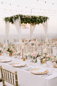 Gorgeous White and Gold Wedding Reception | Glamorous Beach Wedding | Outdoor Wedding Reception Decor Ideas | Beautiful Wedding Ceremony Altar | Floral and Drapery | Hanging Chandeliers