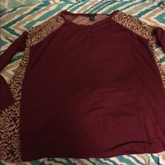 Multi Pattern Henley Top 3X 3X Henley top by Rue 21.  Has multi pattern.  Solid knit burgundy, lace type insets and stripes in back.   Important:  I make sure all items are freshly laundered as applicable (shoes and tagged items, I don't remove the tags and wash).  However, not all my items come from pet/smoke free homes.  Low pricing reflective of this. Thank you for looking! Rue 21 Tops