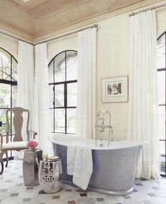 Arched Windows with Drapes in Bathroom