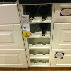 Wine storage built-in. Ikea. In their catalog they had these in the upper cabinets - great repl for our open shelves I dislike!!!