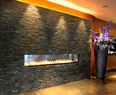 Zero clearance fireplace to be installed in onyx stone surround (featured in Nobu NYC photo) for restaurant entry partition wall of entry/lounge. During warm weather months, firebox area is lined with black zen stones. Restaurant Interior Design, Luxury Interior Design, Interior Architecture, Interior Decorating, Modern Fireplace, Fireplace Design, Recessed Electric Fireplace, Entrance Decor, The Ordinary