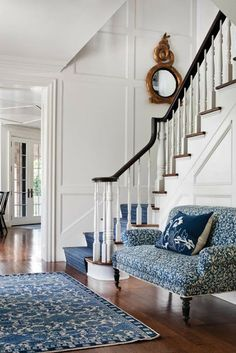 Styled by StacyStyle for @New England Home. Photo by Sam Gray. Blue and white entry. Pattern on pattern.