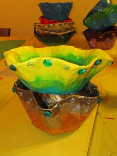 """Chihuly-inspired paper mache bowls; approx. 12"""" and 14"""" wide; lesson by art teacher: Susan Joe"""