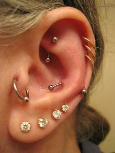 Love the fine gauge triple helix piercing