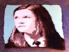 My attempt at 'crochet by numbers'  Ginny Weasley from Harry Potter for my Ailbhe. Thanks to totallee.net for the pattern