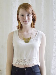 Flirty white crop top with crochet bottom trim.  Fabric is semi-sheer, keyhole back detail.