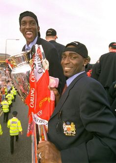 Dwight Yorke and Andy Cole, with the Premier League trophy
