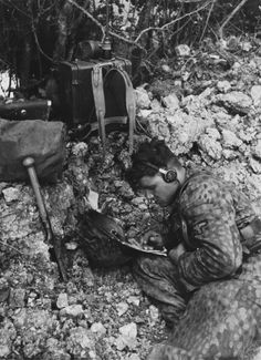 An SS radio operator performs his duties near the town of Caen in late July 1944 following the D-Day invasion that took place the previous month. He is probably a member of Hitlerjugend Division, the most famous unit of the Normandy Campaign.