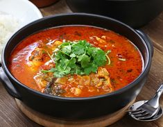 Spicy fish stew flavored with onion, peppers, garlic, cilantro and tomatoes with just a dash of coconut milk! This is a Brazilian stew also known as moqueca which I first had a Brazilian restaurant… Hake Recipes, Tagine Recipes, Shellfish Recipes, Cooking Recipes, Healthy Recipes, Healthy Food, Seafood Stew, Fish And Seafood, Fish Tagine