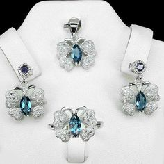 Silver set of ring earrings and pendant. Rocks: London Blue Topaz, iolite(natural) and zirconium Sold by Jewellry 161,00 $