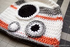 Have you figured out yet that my family is huge into Star Wars?  We love  all of it.  EVEN THE PREQUELS, PEOPLE!  You can find other SW loving  goodies that I've shared along the way HERE, if you so choose.  But right  now, I hope you at least stick around for today's latest crochet pattern: a  BB-8 hat!  It always turns out that the droids are my favorite characters in the Star  Wars series.  R2-D2, C-3PO, Chopper and now BB-8.  They're full of sass,  are hysterical and yet are the most…