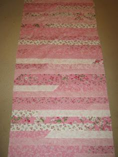 Burnice found a youtube video from USA where a very funny lady makes a quilt from a Jelly Roll against the clock. Apparently these are all ...