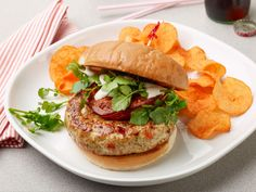 Terrific Turkey Burger : You'll get the same big meaty bites from Amanda's turkey burger as you would from the signature burger at your local greasy spoon, but not the excessive fat. Not only does Amanda opt for lean turkey over beef, but she also works chives, shallots and finely diced red bell pepper into the patties. Once they're grilled, top each burger with delicate watercress and a roasted tomato half.