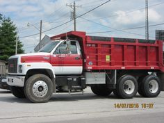 Red & white GMC Topkick dump truck in Flora