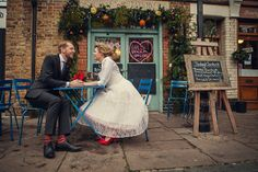 Red Wedding Shoes, a Flirty Fifties Frock and a groom with red socks. Photography by assassynation.co.uk