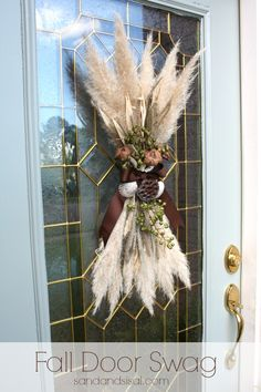Fall Door Swag. Made from pampas grass fronds and given a coastal vibe with a few shells. DIY tutorial on how to make it from Sand & Sisal.