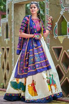 """""""Navratri Chaniya Choli Collection"""" Exaggerated with ethnic Phulkari embroidery and Mirror work in beautiful patterns, this Pure cotton Lehenga in hues of white is paired with matching choli and stunn Choli Designs, Lehenga Designs, Blouse Designs, Blouse Patterns, Lehenga Indien, Kaftan, Cotton Lehenga, Chanya Choli, Phulkari Embroidery"""