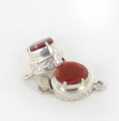 CARNELIAN CLASP STERLING PRONG STYLE FACETED from New World Gems