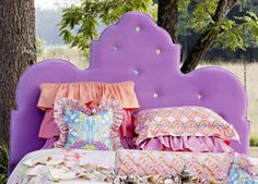 Cute/girly headboard. Could be a nice and simple shape for the b/g. To make: paint or fabric over cardboard