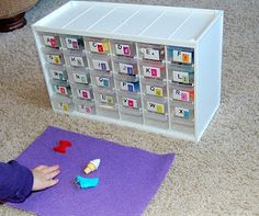 Phonic Box - I love this idea. The teacher I work with does something similar. She has round containers with the letter on it and inside the objects that start with that sound. For the extra spots you might could put blends on them for when you begin to teach those sounds.