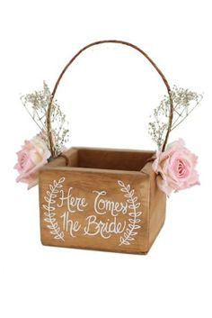 """This beautiful, rustic chic flower girl basket is hand painted with Here Comes The Bride inside a pretty laurel wreath design. Basket handle is accented with baby's breath and paper flowers. This adorable flower girl basket will add just the right touch to your outdoor garden or shabby chic rustic wedding! Features and Facts:  5"""" L x 5"""" W x 3.5"""" T; 10"""" T with handle  Hand Crafted  Cedar wood, Paper flowers, Dried baby's breath  Made in USA"""