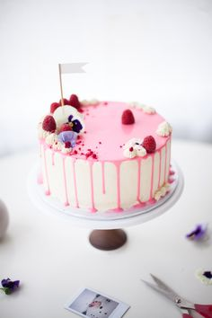 unbirthday inspired drip cake with flowers - coco cake land