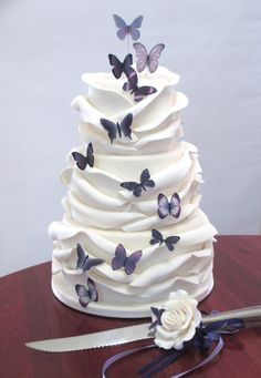 My rose wrap cake with purple butterflies and knife spray....