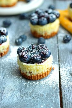 blueberry lemon cheesecake bites make the perfect wedding dessert Lemon Blueberry Cheesecake, Mini Cheesecake Recipes, Cheesecake Bites, Blueberry Jam, Blueberry Wedding, Cupcakes, Cupcake Cakes, Köstliche Desserts, Delicious Desserts