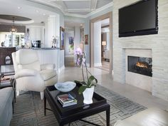 Transitional Family Room, stone fireplace, white walls and furniture  - Park Shore - Naples, Florida