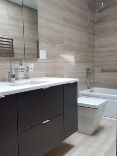 Wall hung espresso vanity, quartz counter, Kohler alcove tub, Kohler faucets, large tiles