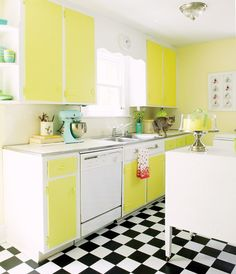 I'm proud to say that I have a yellow kitchen almost as awesome as this one.  Note to self - go for NEON next time...