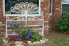 A headboard from an old bed my wife put in the garden.  It'll look great when the Clematis climbs all over it.