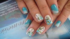Turquoise nails.. Specially crafted flora drawings. Call our artist at 63488930 to design one for u.
