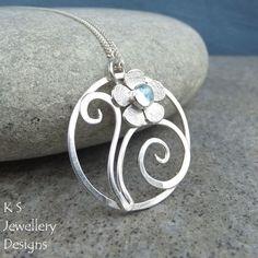 Blue Topaz Flower & Swirls Circle Sterling Silver Pendant - Handmade Metalwork £50.00