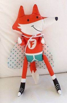 Fab Fox is a dandy superhero with turquoise undies, a starry reverse-able cape and snazzy sneakers. His arms and legs move, and his cape is remove-able.  http://www.spoonflower.com/fabric_items/new?design_id=731186