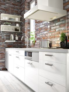 METOD kitchen | IKEA White cupboards and brick wall