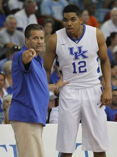Bahamas12:  University of Kentucky freshman Karl-Anthony Towns gets some instructions from Coach John Calipari against the Puerto Rico national team. August 10, 2014. Cats win it 74-49. It is like Christmas in August in the BBN!!