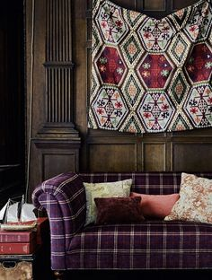 Buckland Fabric An eye-catching woven fabric with a geometric diamond and hexagon design reminiscent of Kilim rugs, printed in earthy shades of plum, brown and green. Sections of the design have been embroidered, adding depth and interest to the fabric.