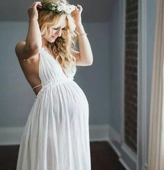 Simple white dress and a floral crown for maternity photos